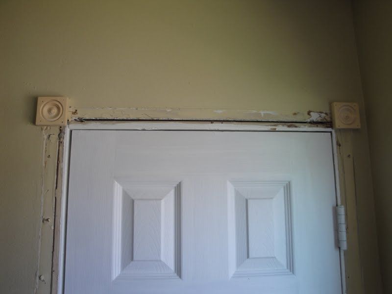 I nailed up the rosettes first. & my kind of makeover: Replacing Door Casing