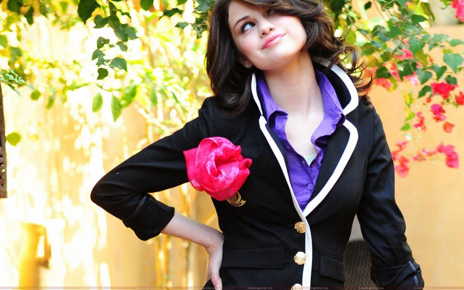 http://2.bp.blogspot.com/-fguZQzL-ibs/TfoXTC2JceI/AAAAAAAAFrE/bMgzxelT4KU/s1600/teen_selena_gomez_with_rose.jpg