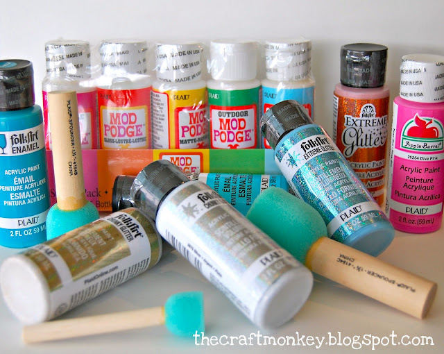 Mod Podge and paint containers