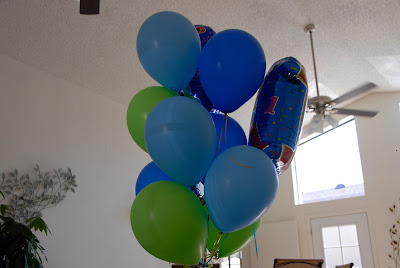 blue birthday balloons touching the ceiling