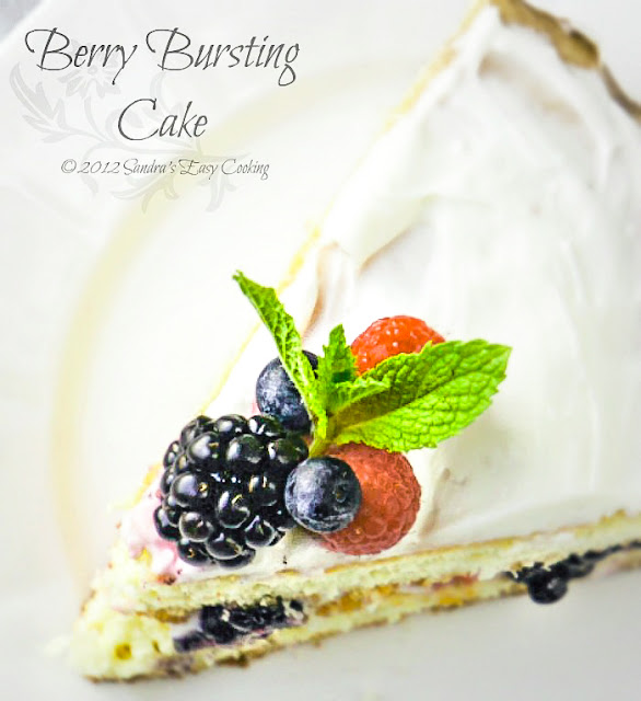 Summer or Spring Berry Bursting Cake. Delicious and with loads of fresh mixed juicy berries.
