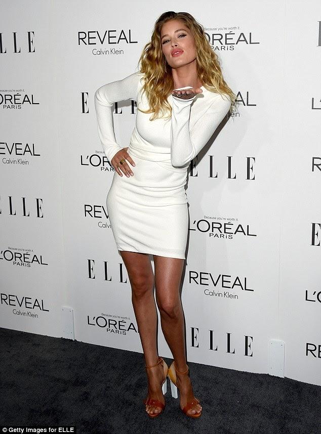 ما هو سرها؟ توتزن كروس تبدو متألقة في فستان أبيض بعد ثلاثة أشهر فقط من الولادة