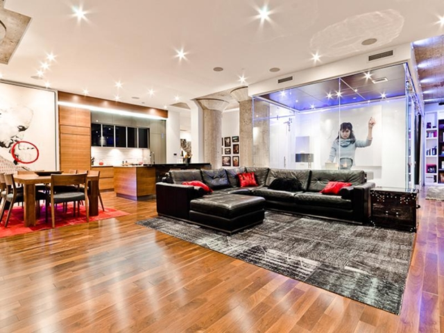 Living room with dinning room, the kitchen and glass cube in the background