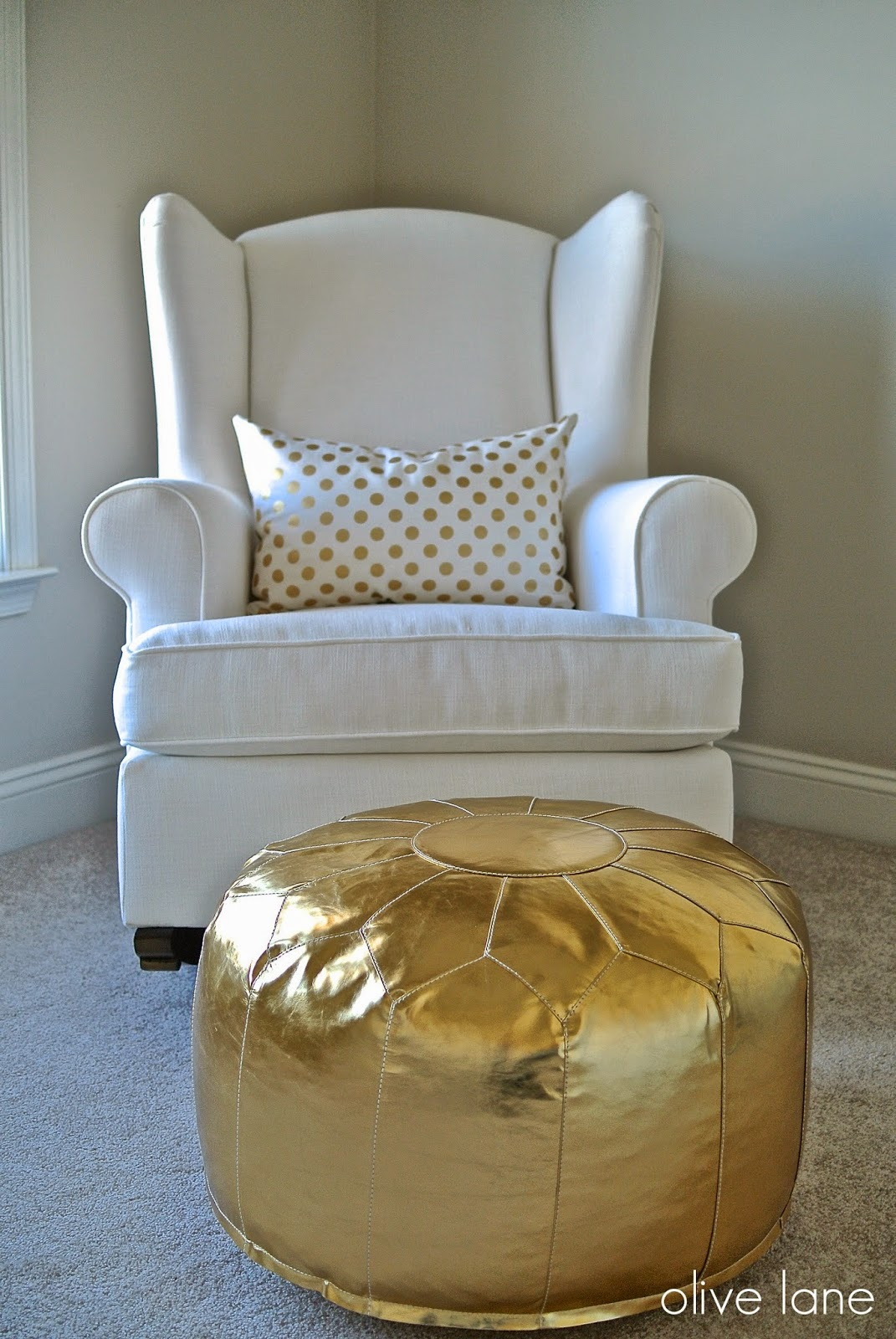 Pottery Barn Wingback Rocker White Caitlin Wilson Gold Dot Pillow Land of Nod Gold Pouf www.olivelaneinteriors.com