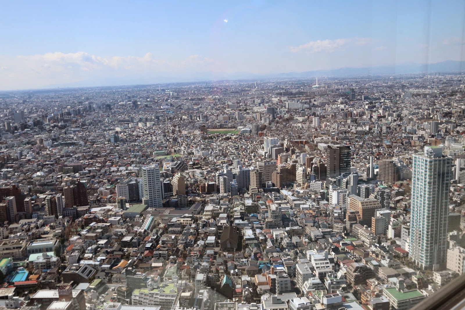 Look at how compact and high density Tokyo city is from the observation deck of Tokyo Metropolitan Government Building in Shinjuku, Japan