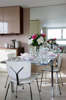 Contemporary Reflective Dining Room Tables For Small Spaces with some White Chairs near the Minimalist Kitchen