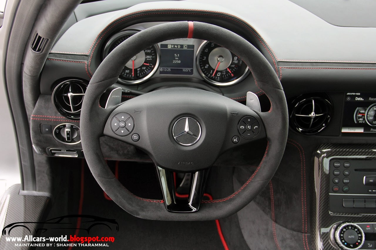 a functional sporty racing car atmosphere is prevalent inside the mercedes benz sls amg black series with high quality materials demonstrating precision