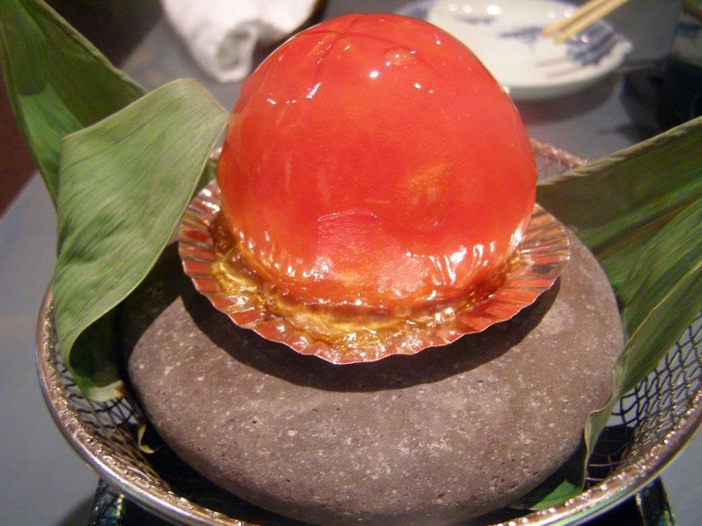 Grilled whole tomato filled with tripe, whelk, shrimp and mushroom