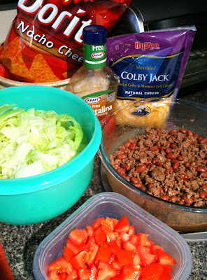 Taco Salad, with Doritos! -- BEST salad ever. Great for potlucks and picnics.