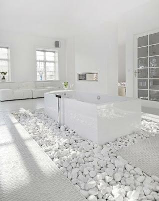white bath tub in white stones - gorgeous