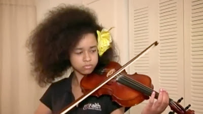 African-American girl won't face expulsion over 'natural hair'