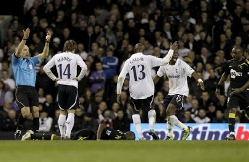 Bolton player Fabrice Muamba lies on the pitch after collapsing during a game against Tottenham