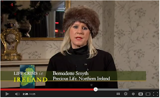 Bernadette Smyth of Precious Life, wearing a ridiculous fur hat indoors.