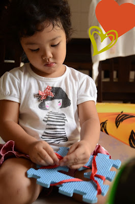 Kecil busy tinkering