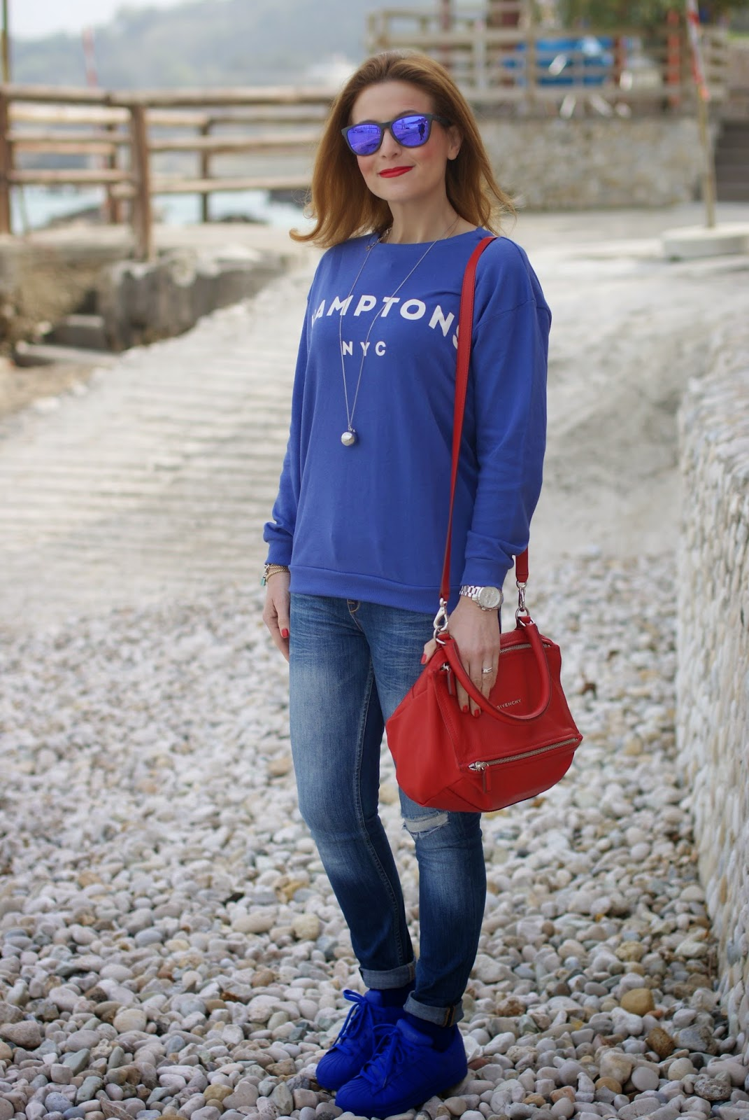 Fashion blogger wearing adidas bold blue adidas supercolors, Givenchy Pandora red, casual look for a day at the sea, Fashion and Cookies