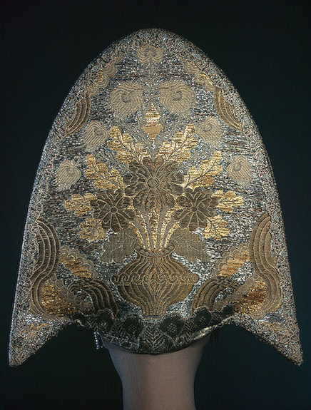 Traditional head wear of Russia made from brocade and decorated with mother-of-pearls, pearls and glass