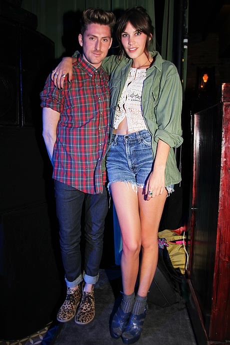 """With one of his many """"it girl"""" friends, Alexa Chung."""
