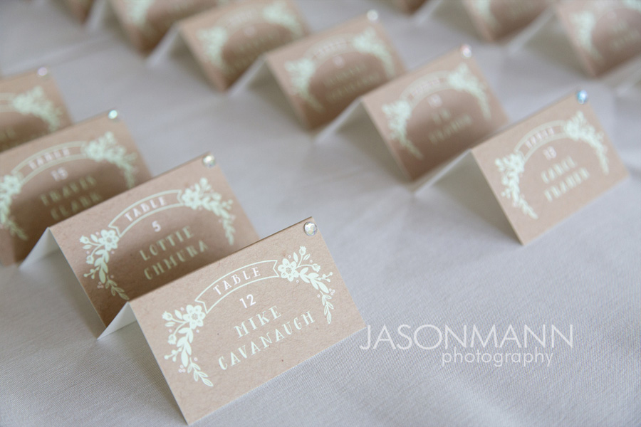 Door County wedding reception name cards in a brown-gray and teal lettering. Photo by Jason Mann Photography, 920-246-8106, www.jmannphoto.com