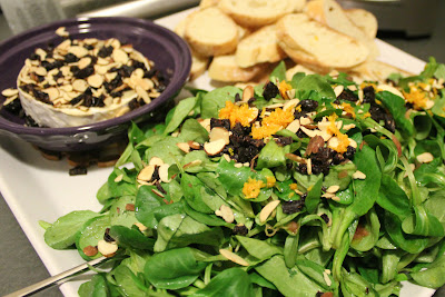 Baked Brie with toasted almonds, dried cherries, and mache
