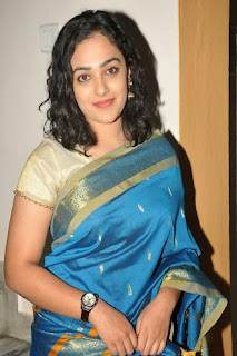 Actress Nitya Menon Pictures in Saree at Malini 22 Audio Launch  0002