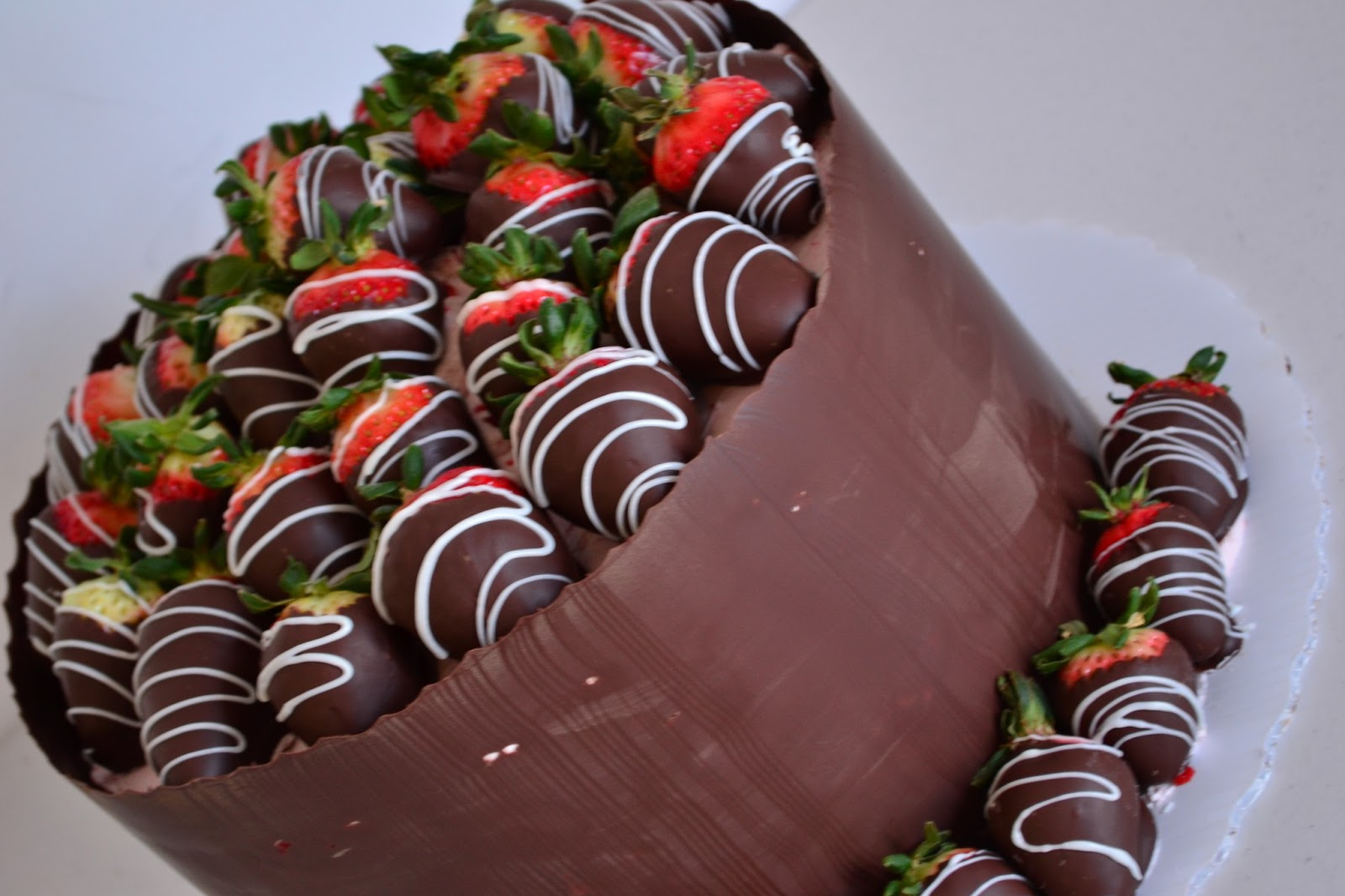 Oh, just put a cupcake in it....: Chocolate Covered Strawberry Cake...