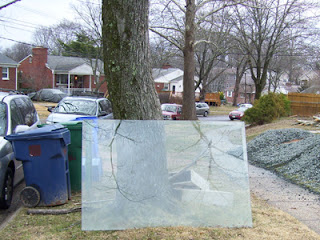 Glass sheet at the curb for bulk trash pickup.