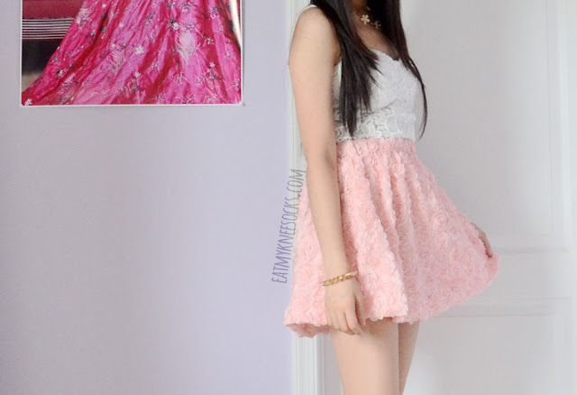 Dress up for a romantic summer date with a flirty pastel skirt, cute bustier top, and floral necklace.