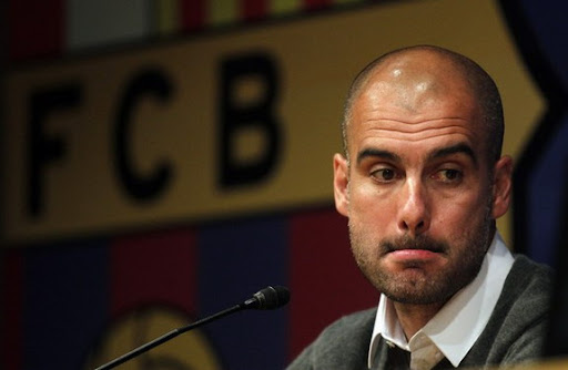 Departing Barcelona coach Pep Guardiola looks on during a news conference