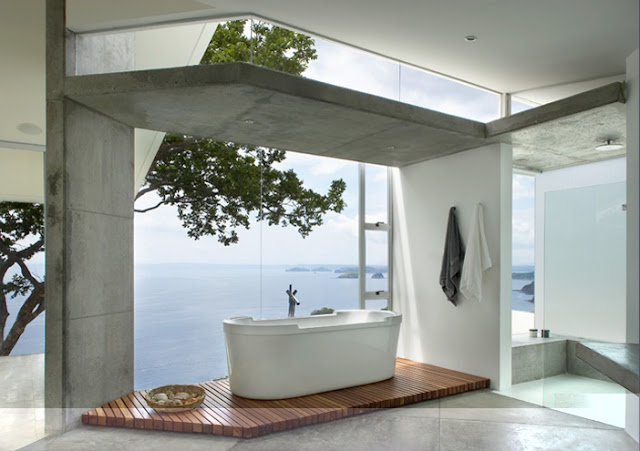 Photo of amazing bathtub by the window overlooking the ocean