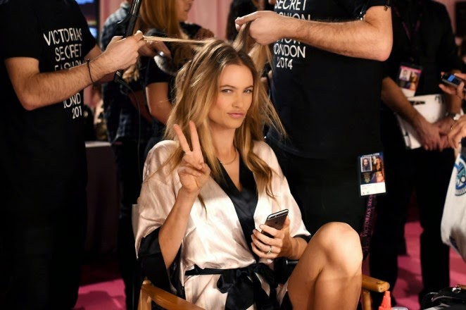 Victoria's Secret models pose backstage ahead of the 2014 VS Fashion Show in London