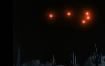 A glowing red V-shaped object in the sky near Springbrook.