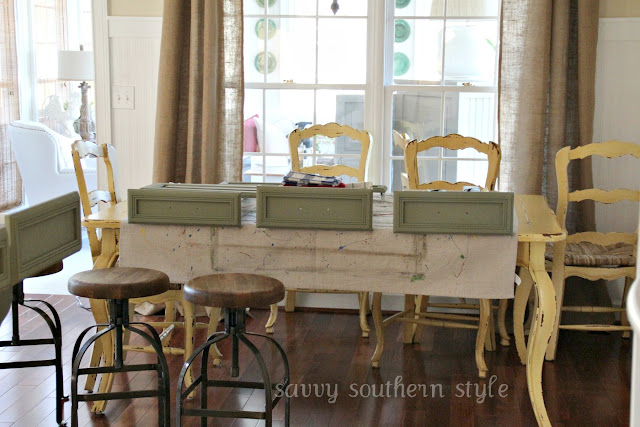 Luxury I removed all the drawers and set them on the table and counter I decided I could paint the doors with them on Thank goodness there were only four doors