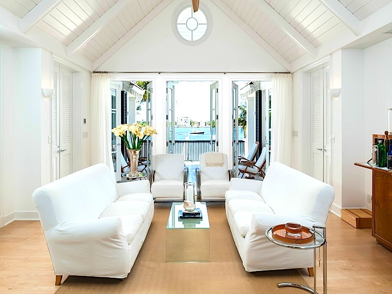 White living room with dueling sofas