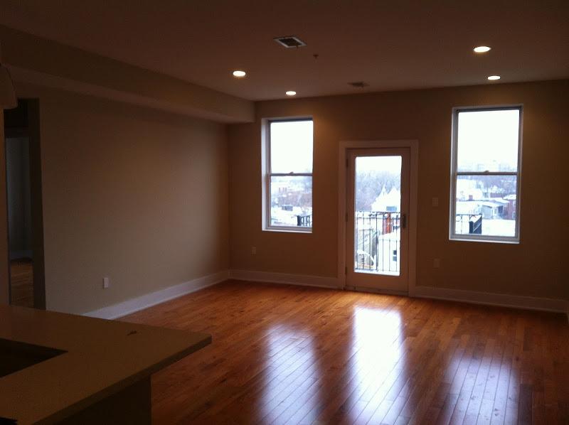 It has gleaming hardwood floors. title=