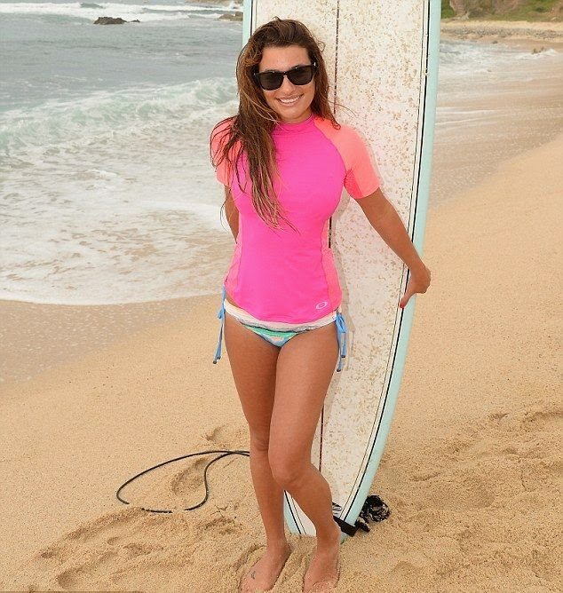 The 27-year-old hit the beach in Cabo San Lucas, Mexico on Monday, June 23, 2014 for a spot of pose alongside a surfboard.