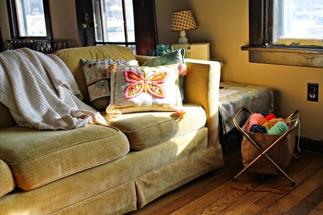 retro living room at va voom vintage yarn basket, vintage yellow sofa, throw pillows and radio