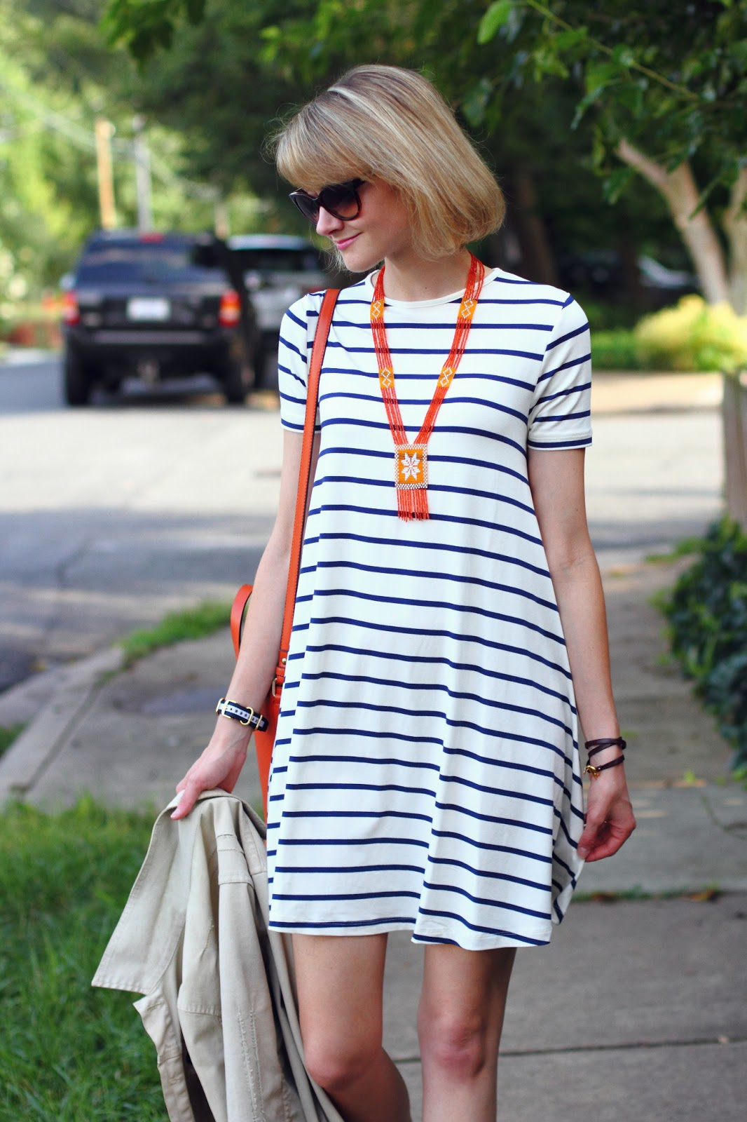 orange beaded necklace and striped swing dress
