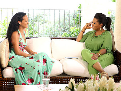 Rihanna and Oprah both Sitting on couch to start the interview