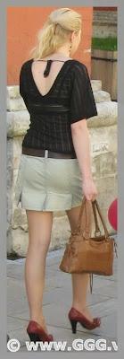 Girl in summer skirt on the street