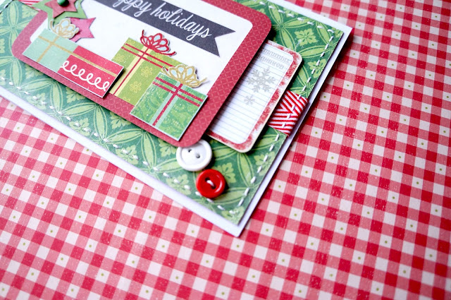 Stitching and buttons in christmas card.