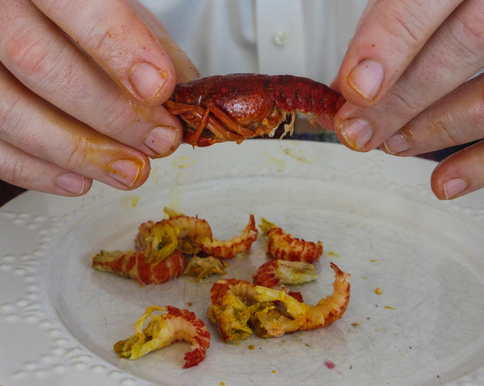 Crayfish Tails On The Plate And Getting Ready To Get Another Tail Note The  Yellow On My Fingers And On The Tail It Is Crawfish