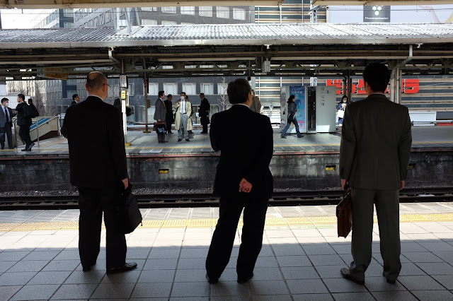 Japanese salaryman photo suits train station