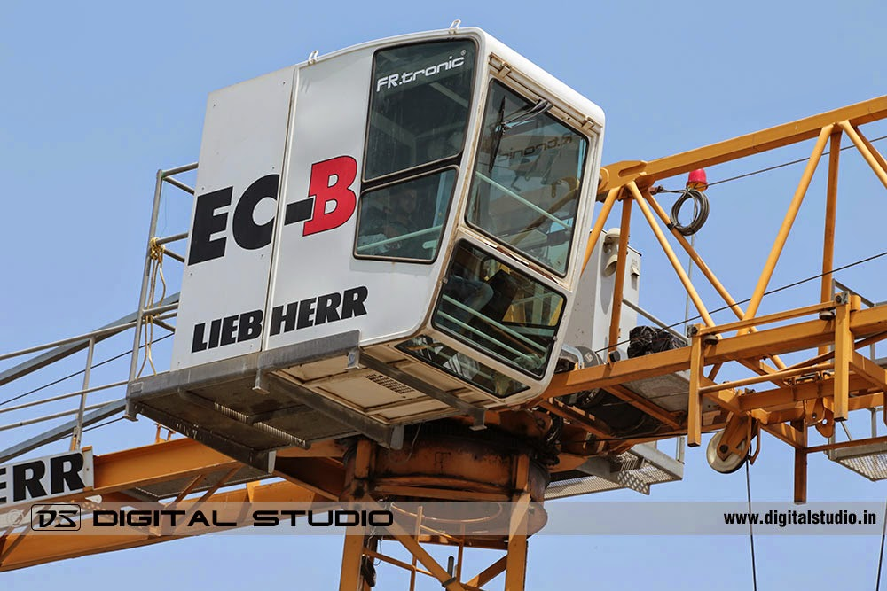 Close-up photograph of tower crane cabin with operator