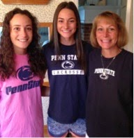 Her sister, Maria, Caroline and her mom supporting their favorite team