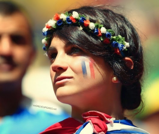 Beautiful French girl watching the World Cup 2014