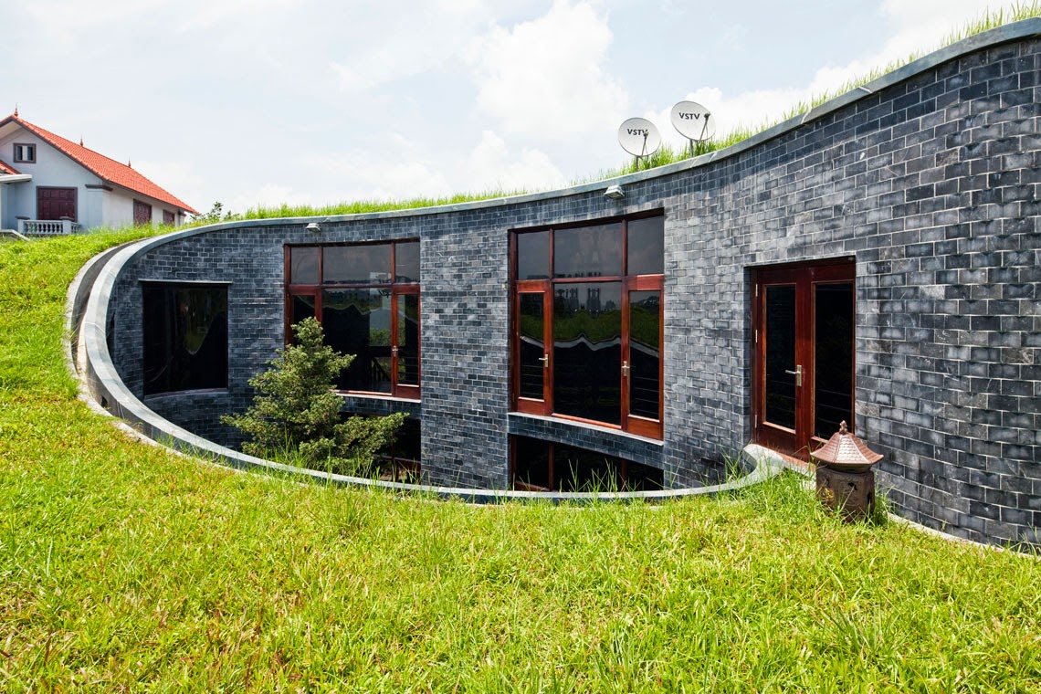 Stone house with grass roof and central garden modern for Modern stone houses architecture