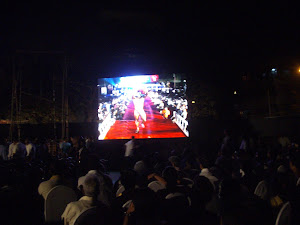 Giant screens akin to a rock concert  displaying the  Bodybuilding show.