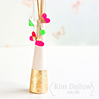 A gold touch added to a vase with gilding flakes