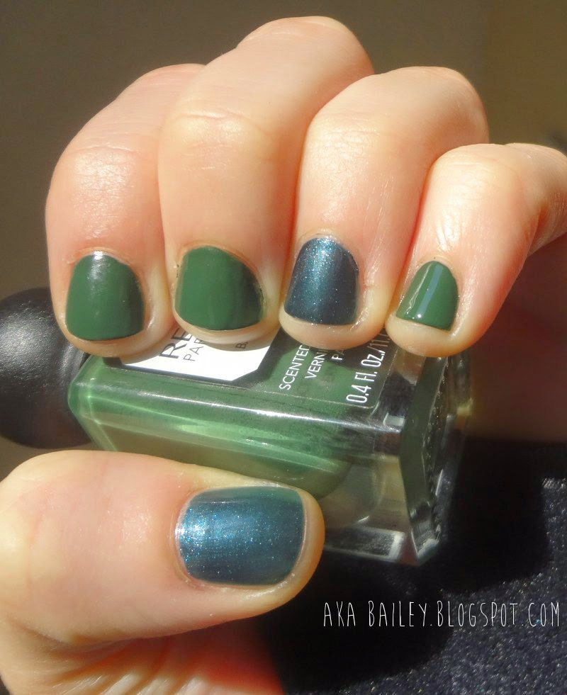 Revlon Parfumerie Balsam Fir with navy teal accent nails