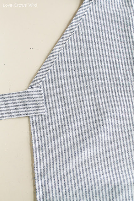 Learn how to make this sweet apron from a men's dress shirt so you can look cute while you cook! Perfect for beginner sewers! | LoveGrowsWild.com